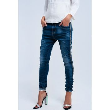 Skinny jeans with side pearls detail