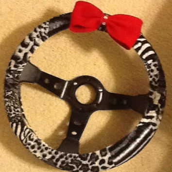 Gray cheetah print steering wheel cover with red bow
