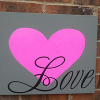 "18x16 hand painted canvases in gray with a hot pink heart with vinyl lettering  ""love"" in black."