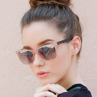 Pink clear acetate sunglasses contrast with dark tortoiseshe