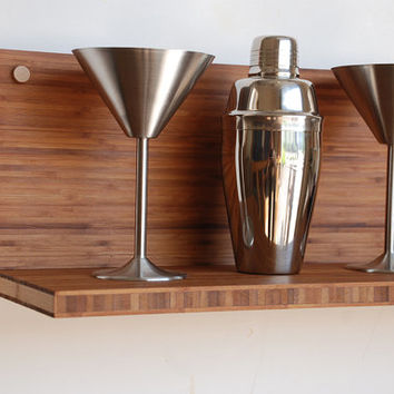 Classic martini shelf with glasses, shaker and coasters