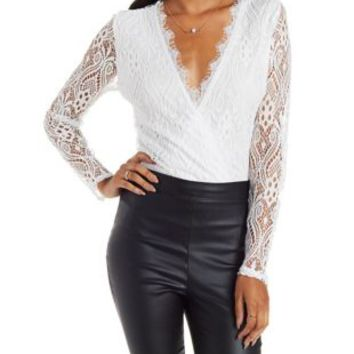 Pale Blush Long Sleeve Lace Wrap Bodysuit by Charlotte Russe