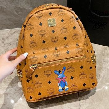 MCM fashion hot seller men and women full of printed ribbed rabbit graffiti backpack High quality