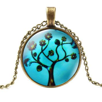 Massive vintage necklace, collar with bronze chains and pendants of glass cabochon with the image of the tree of life,