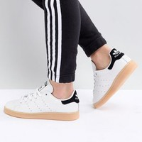 adidas Originals Stan Smith Sneakers In Off White With Gum Sole at asos.com