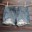 distressed denim low rise shorts with crochet detailing