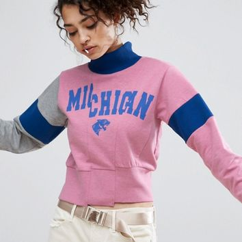 ASOS Sweat With Funnel Neck And Cutabout Print at asos.com