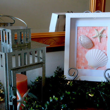 Beach wall decor for your coastal home. Perfect for a beach theme bedroom or bathroom.  Seashell art in a shadow box.  Orange Coral