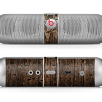 The Rough Textured Dark Wooden Planks Skin for the Beats by Dre Pill Bluetooth Speaker