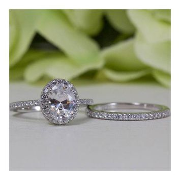 Halo Oval Brilliant Cut Fine Quality Cubic Zirconia Engagement Ring Set In Sterling Silver