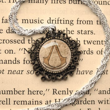 Assassin's Creed symbol inspired Vintage and Antique Style Frame glass cabochon dome pendant necklace
