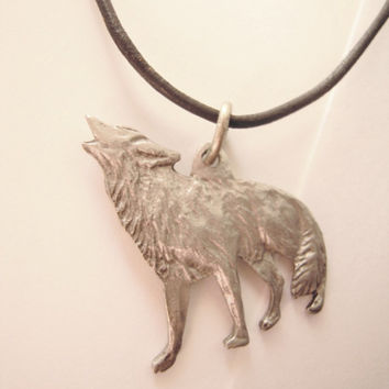 "Pewter wolf charm necklace . adults . teens . kids . leather strap . flexible length . up to 26"" . howling wolf . animal lovers . N. America"