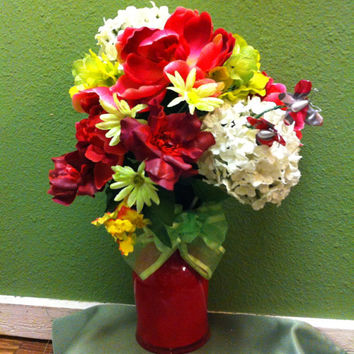Handmade artificial floral arrangement, spring colors with butterfly accents.
