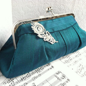 Teal clutch purse with peacock feather rhinestone brooch, teal green silk clutch bag in frame
