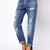 ASOS Brady Low Rise Slim Boyfriend Jeans in Mid Wash Blue With Rips