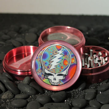 Medium size Pink Steal your Face herb grinder 4 piece aluminum with scraper