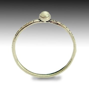 Sterling silver Tiny, thin, grooved band set with a small pearl stone - Time out