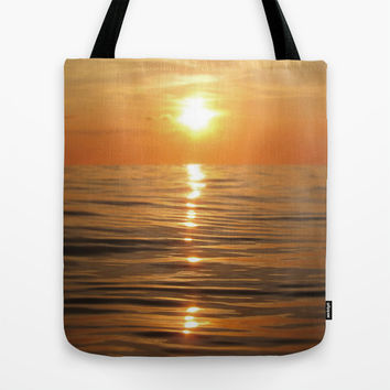 Sun setting over calm waters Tote Bag by Nicklas Gustafsson
