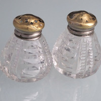 Cut Glass salt / pepper shakers brass color tops