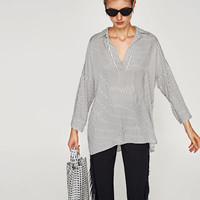 STRIPED OVERSIZED BLOUSEDETAILS