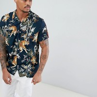 River Island revere collar shirt with tiger print and side stripe in navy at asos.com
