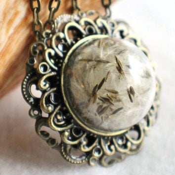 Dandelion seed glass pendant on antique bronze chain adorned freshwater pearl and bronze wish charms