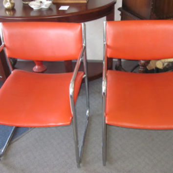 Pair of Mid-Century Modern Orange Vinyl/Chrome Arm Chairs 1960s/70s