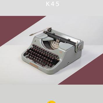 RESERVED /// 1950's Mercedes K45 Typewriter. Restored & fully working. Gray and burgundy. German portable. East Germany. With case.