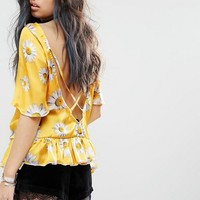 Milk It Vintage Short Sleeve Top With Ruffle Hem And Deep V Strappy Back In Festival Daisy Print at asos.com