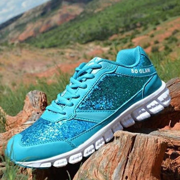 Turquoise glitter tennis shoes