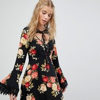 Kiss The Sky Tea Dress In Floral With Tie Neck Detail at asos.com