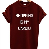 SHOPPING IS MY CARDIO T SHIRT FUNNY SWAG RETRO MEAN GIRLS MINDY PROJECT UNISEX