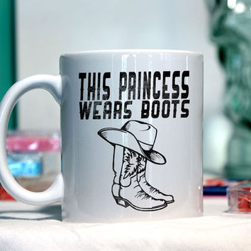 This princess wears boots - Ceramic coffee mug - funny sayings
