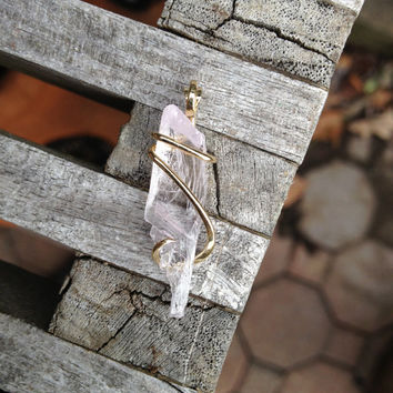 kunzite shard tension set in hand forged polished 14 karat gold
