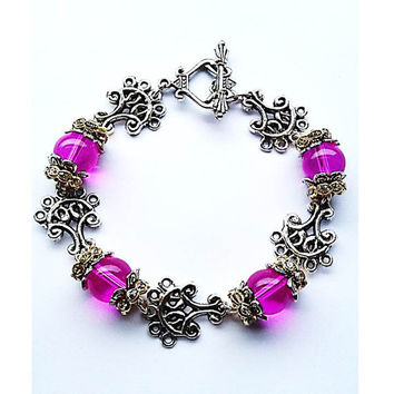 Translucent Pink Bead  and Pewter Pendant Bracelet Attached To A Vintage Clasp