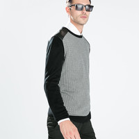 HOUNDSTOOTH SWEATER WITH FUAX LEATHER APPLIQUE