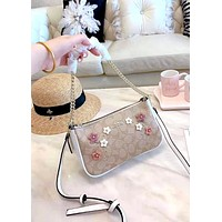 COACH 2019 new women's fashion decals heavy work shoulder small bag crescent bag