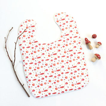 Large baby or toddler bib. White cotton with toadstools. White cotton terry back. Toadstool baby bib. Red white mushrooms