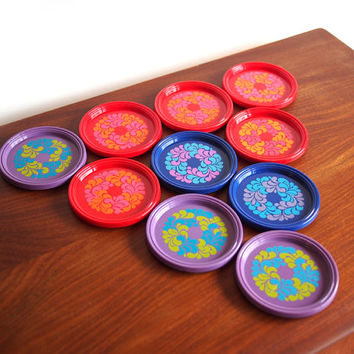 Vintage multi-coloured plastic coasters. Printed abstract floral design. Emsa West Gremany. 60s /70s