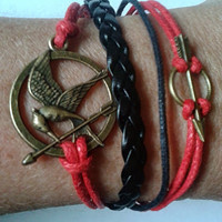 Hunger Games Inspired Black & Red  Braided Leather Infinity Bracelet ~ with bronze arrow and bird/mocking or jay charms
