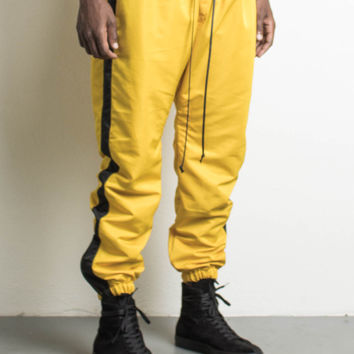 parachute track pant / yellow + black