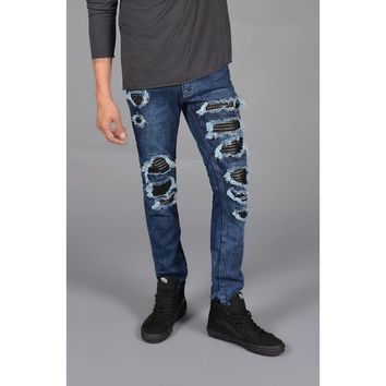 The Distressed Leather Patched Jeans in Indigo