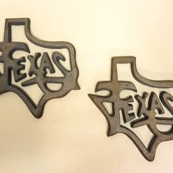 2 Texas Cast Iron Trivets Plaques Paper Weights
