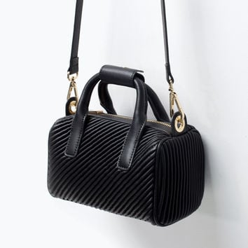 Quilted mini bowling bag