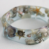 seashell swirl eco resin bangle with shells and by RosellaResin