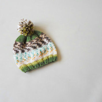 Knit Baby pom pom hat. Hand knit selp pattern yarn pom pom hat baby and toddler. Greeny.