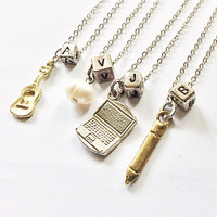 Riverdale Friendship Necklace: Archie's guitar, Veronica's pearl, Jughead's laptop, Betty's pencil