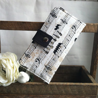 Musical note wallet with black contrast color-  Card slots- 2 Bill slots and Zippered coin pouch