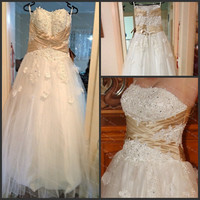 Strapless sleeveless floor-length tulle with appliques wedding dress