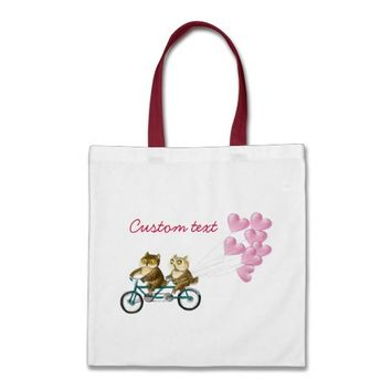 Owls on a bike with baloons